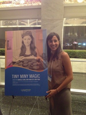 Director Danielle Lurie next to the poster of her short film, Tiny Miny Magic.