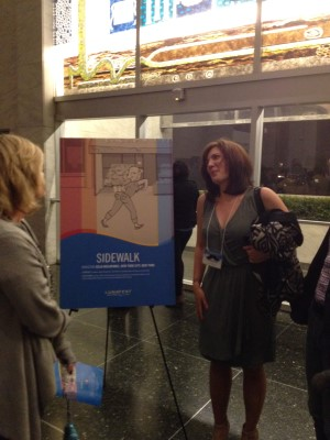 Director Celia Bullwinkel by her Sidewalk film poster.