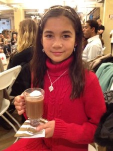 The best part of the fashion show? Isabella enjoying her hot chocolate!