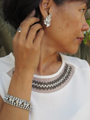 Vintage rhinestone jewelry is a spot-on match for the blouse's neckline embellishment.