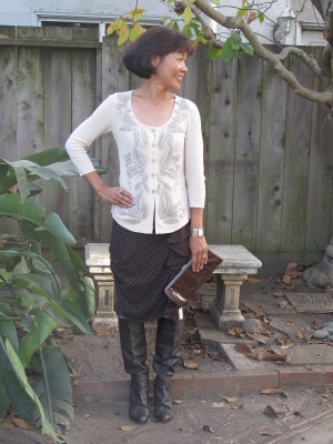 Winter-white sweater, polka-dot skirt with swags, and slouchy soft boots.