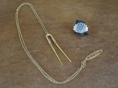 A Peace Treaty long necklace and sterling silver fan ring giving off Art Deco vibes.