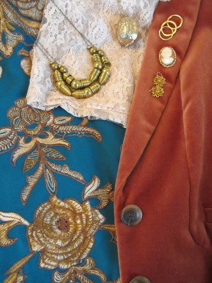 Textures and colors: Burnt orange, turquoise, lace, velveteen, embroidery.