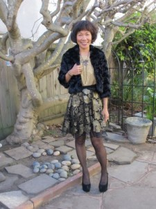 Dressed for a real high tea party: faux fur jacket, gold jacquard blouse, and flared black and gold flowered skirt.
