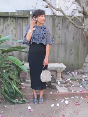Warm weather means sleeveless in winter: pleated skirt, crocheted capelet, and vintage rhinestone and silver accessories.