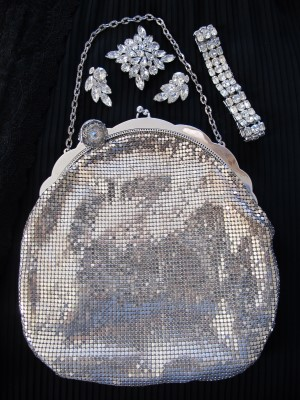 Vintage mesh and rhinestone are stunning accessories against black.