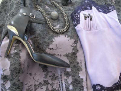 To wear the coat as a dress, slip on a lace-edged camisole the soft lavender color of the lining and printed trees and a lightweight knit black skirt beneath.