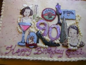 90th birthday cake celebrates important milestones in the birthday woman's life.