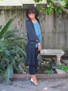 Pleated duster made elegant by lace and metallic pointy pumps.