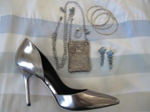 Cool silver accessories against muted colors.