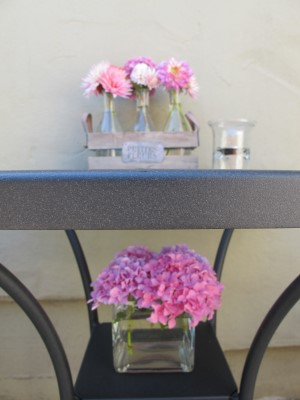 Details, details - smaller vases to house short-stemmed flowers. I added a flat, rectangular vase on the shelf that braces an umbrella stand for a floral tiered effect.