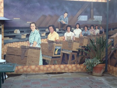 "Detail from mural ""Packing Ladies"" by Colleen Mitchell-Veyna, 1997, 119 S. E. Street."