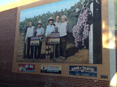 "The mural, ""The People Behind the Label,"" by Chuck Caplinger, 2000, 251 E. Pine Street."