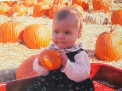 Isabella's turn in the pumpkin patch, 9 months, September 2003.