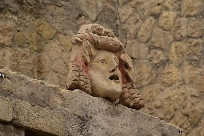 Statue head in a bath house.