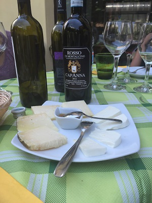 Last bottle of sangiovese served with hard and soft cheese.