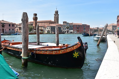 Boat docked on the island of Murano.