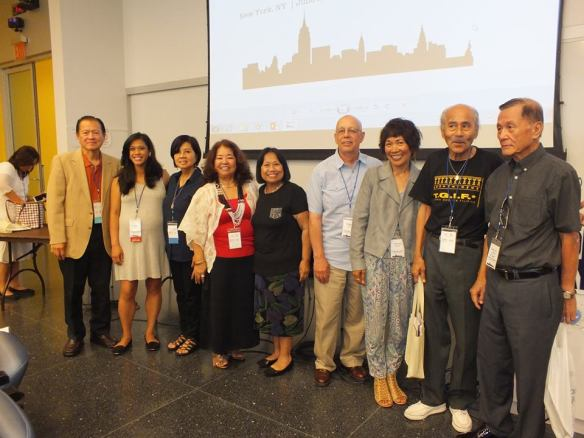 Both author panels pose for a group photograph.