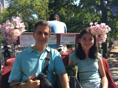 David and Isabella, before she took our driver's invite to lead our horse through Central Park (photo by me).