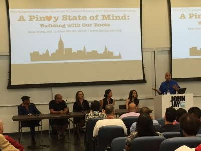 Kevin Nadal moderates a panel comprising, from left to right, Joe Bataan, DJ Neil Armstrong, Ernabel Demillo, Rachelle Ocampo, and Jaygee Macapugay.