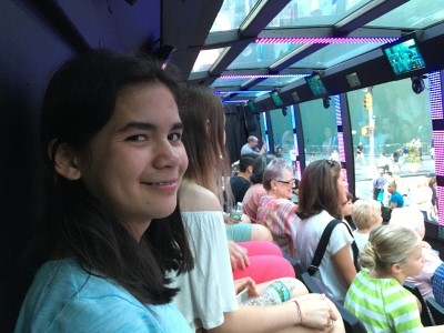 Isabella much prefers the bus tour over a baseball game (photo by Heidi)!