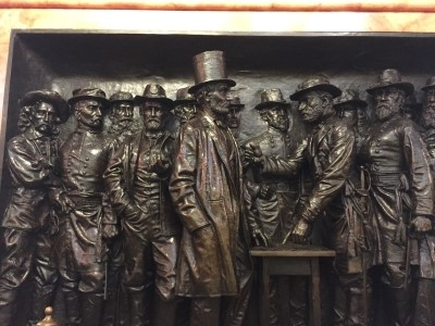 Bronze relief panel with Abraham Lincoln inside the museum.