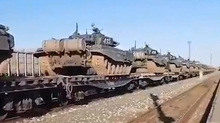 A still from a video reportedly showing a trainload of tanks in southwestern Russia headed in the direction of the border with Ukraine.