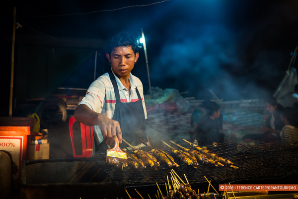 A vendor grills his chicken in Siem Reap. Photo by Terence Carter.