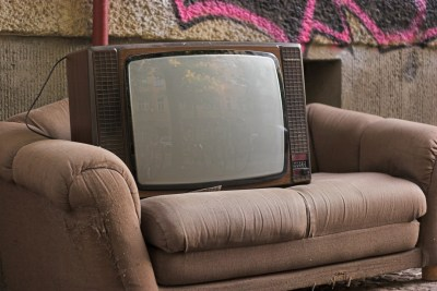 An old television set sitting on a couch