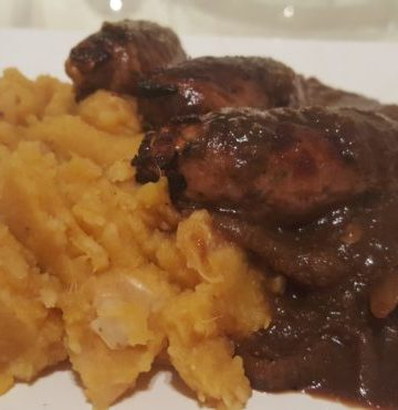 Garlicky sweet potato bean crush, sausages and onion gravy. Glutenfree