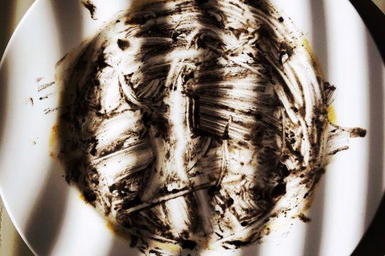 Art photography empty plate squid ink risotto saffron