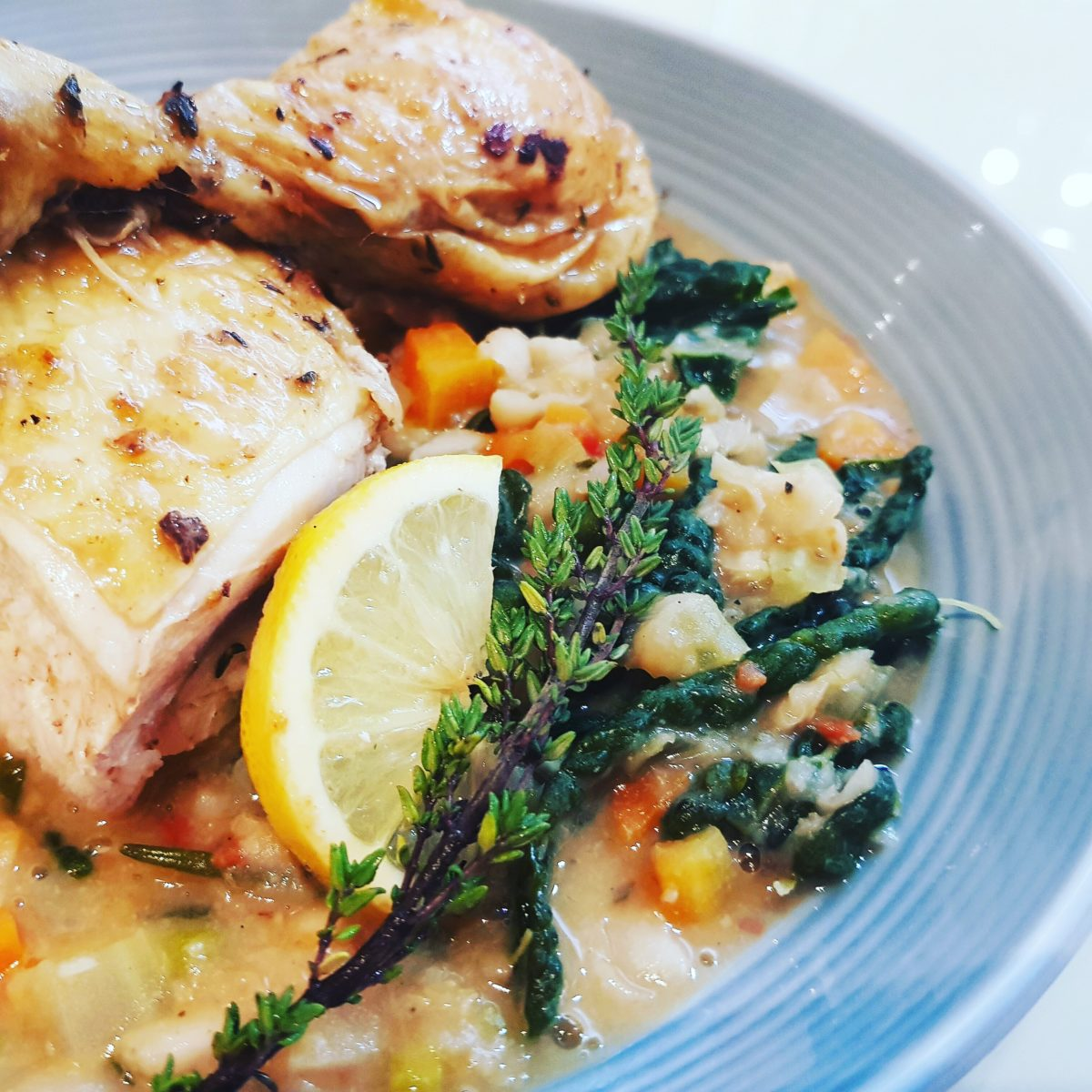 spatchcock roast chicken with lemon thyme and bean stew