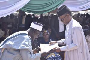 """Gov. Rufai Presenting a copy of """"The Kafanchan Peace Declaration"""" at the Installation of the new Agwatyap"""