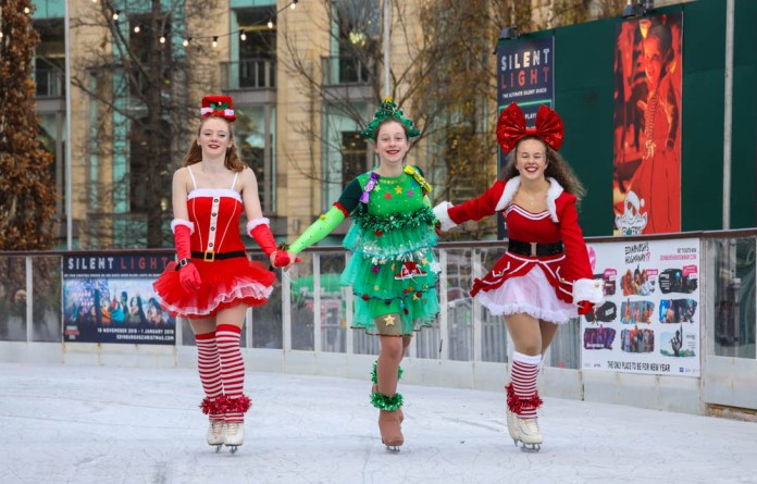 Three skaters on the ice