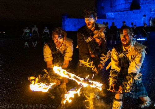 Three men with fiery swords in front of blue castle