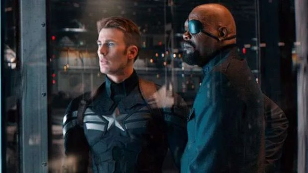 Chris Evans as Captain America and Samuel L. Jackson as Nick Fury in Captain America: The Winter Soldier.