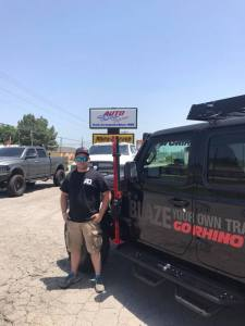 Owner Joel Smith standing outside his new shop, Auto Definitions.
