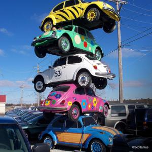 Because who wouldn't want to see multi-colored VW bugs piled high?