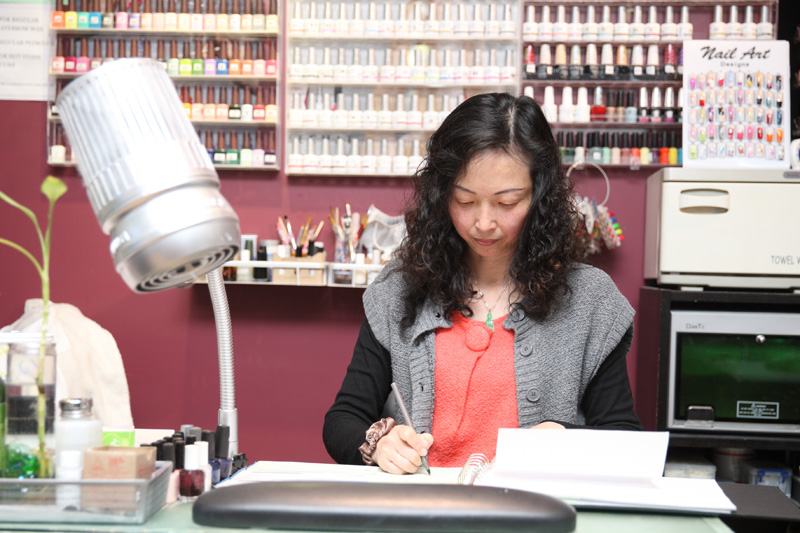A Nail Salon Owner In The Bronx Writes Check To New York State Pay