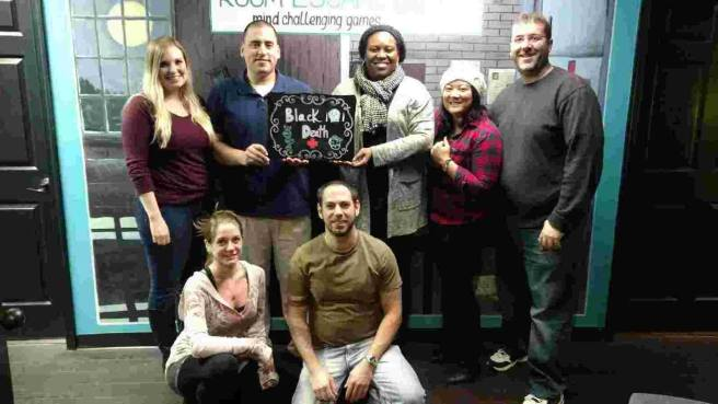 Team Disturbed Friends (Katheryn, Mark, Stephanie, Mike; Tara, Jason) found the antidote and prevented the outbreak of the plague (and didn't die themselves!). Photo courtesy of Room Escape DC's Facebook page.