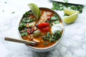 Chicken Tortilla Soup topped with sour cream and a lime