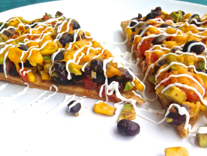 Black Bean Burrito Pizza in the oven - The Burrizza! - Recipe at www.mybottomlessboyfriend.com