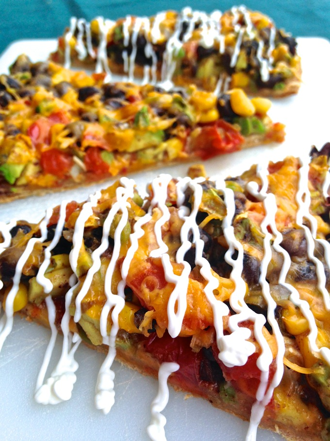 Black Bean Burrito Pizza in the oven - The Burrizza! - Recipe at www.mybottomlessboyfriend.com