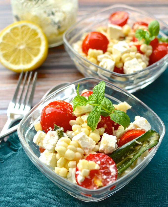 My favorite summer veggies in a simple summer dish! Summer Corn & Tomato Salad with Jalapeno-Lemon Feta at www.mybottomlessboyfriend.com