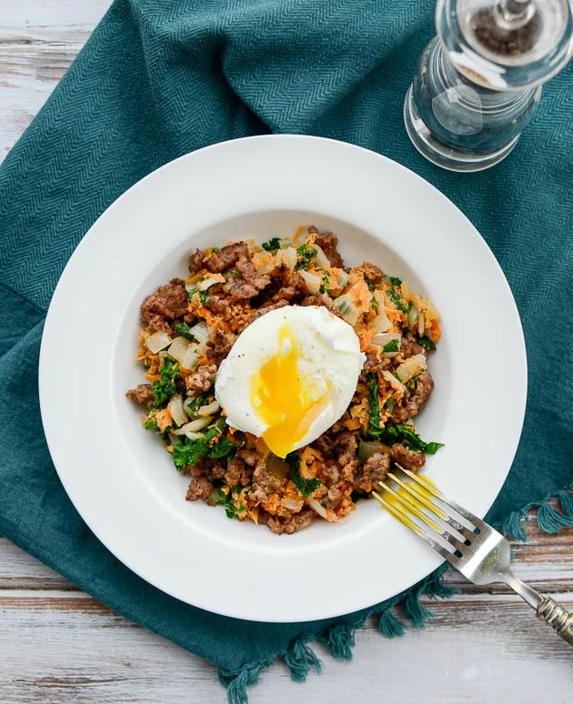 Sweet Potato & Kale Hash with Spicy Sausage is gonna blow your mind! | www.mybottomlessboyfriend.com