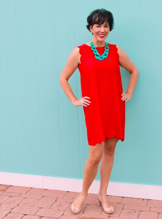 image - red dress and turquoise necklace