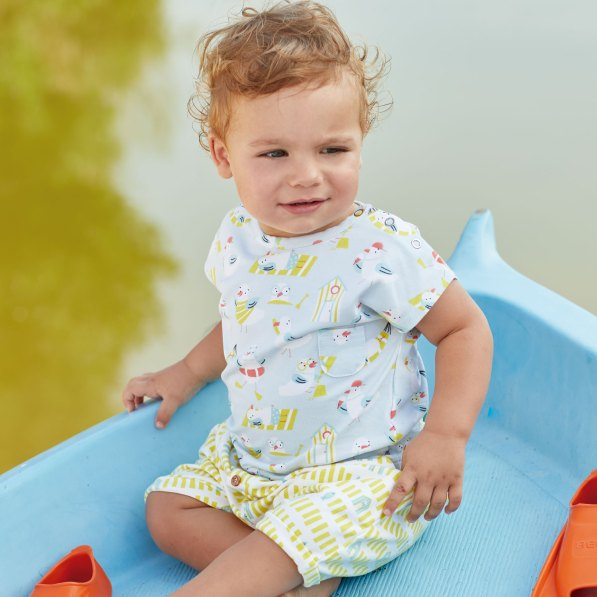 child wearing seagull and beach hut fabric
