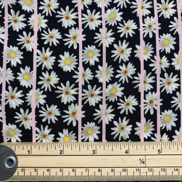 black viscose with daisy print with ruler