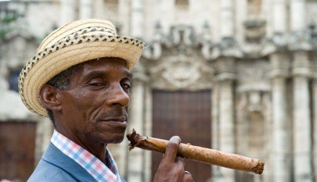 A man smoking a Cuban cigar.