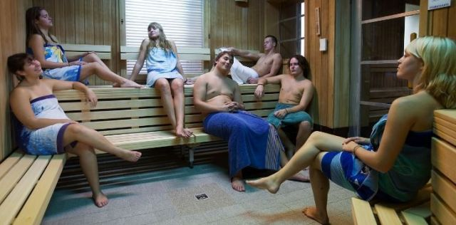 A hungover group of people sweating it out in the sauna